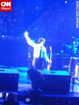 Lifelong Beatles fan Kurt Bentzen of Denmark got this photo of Paul McCartney playing a concert in London in December 2009. He gives The Beatles some of the credit for his mastery of English.