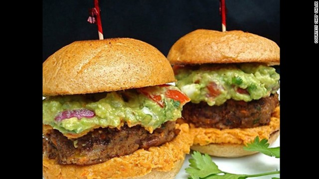Caramelized onions are folded into black bean patties, then topped with homemade guacamole for these vegan-friendly Mexicali sliders.