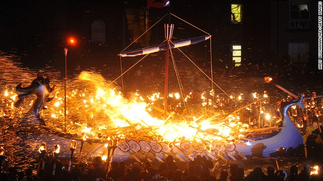 The pyromaniacal revelry ends in the setting ablaze of a replica Viking galley, suggesting ambivalent feelings toward the islanders' marauding Scandinavian forebears.