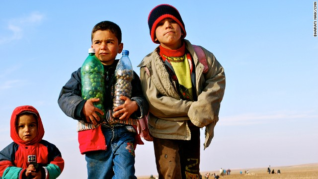Roughly half of the refugees making their way into Jordan are children, many carrying olives and other goods from their farms as a reminder of what they've left behind.