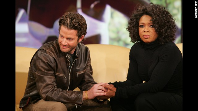 Interior designer and television personality Nate Berkus (seen here with Oprah Winfrey) lost his partner, <a href='http://www.oprah.com/oprahshow/In-Memoriam-Remembering-Oprah-Show-Guests' target='_blank'>Fernando Bengoechea</a>, during a 2004 tsunami while the pair was vacationing in Sri Lanka. Berkus is now engaged to Jeremiah Brent. The pair appears in a new Banana Republic campaign featuring real couples.
