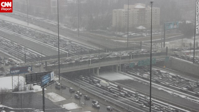"A rare snowstorm left thousands of motorists trapped on Atlanta interstates overnight. ""Thank God I walk to work everyday,"" said <a href='http://ireport.cnn.com/docs/DOC-1079053'>Doug Simonton</a>, who snapped this photo Tuesday afternoon."