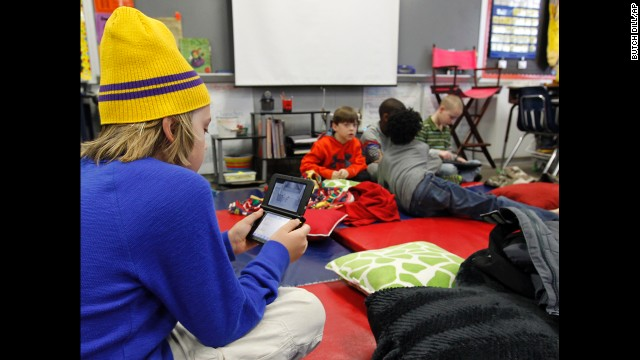 Gavin Chambers plays an electronic game January 29 at Oak Mountain Intermediate School in Indian Springs, Alabama. The severe weather forced thousands of students to spend the night in various school buildings across the state.