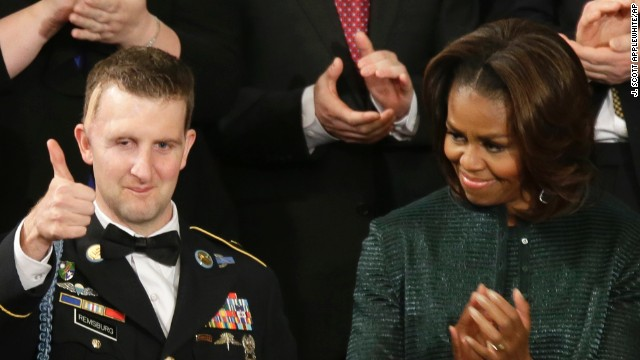 Army Sgt.1st Class Cory Remsburg, who was wounded in Afghanistan and awarded the Bronze Star and the Purple Heart, acknowledges thunderous applause for him at U.S. Capitol during President Barack Obama's State of the Union address.