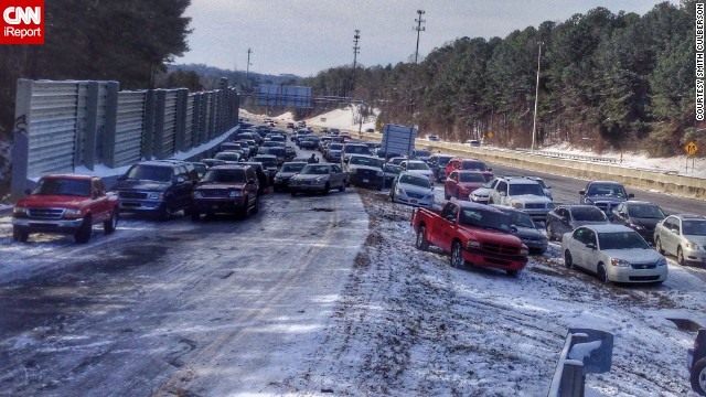 "While walking to the grocery store in Roswell, Georgia, Smith Culberson came across <a href='http://ireport.cnn.com/docs/DOC-1079497'>an entire highway of abandoned vehicles</a>. ""Most cars couldn't drive up the exit ramp because of the ice,"" he said."