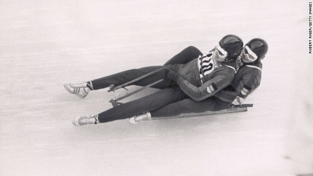 Unidentified athletes participate in the luge event at the 1964 Winter Olympics in Innsbruck, Austria.
