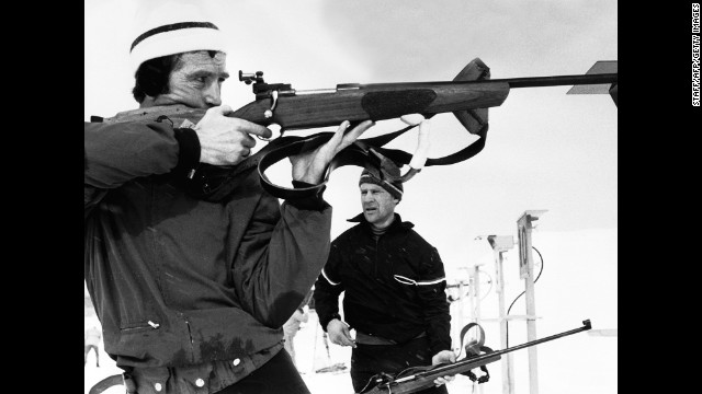 Norwegian Magnar Solberg shoots targets during practice for the biathlon (20-kilometer cross-country ski race and rifle shooting) in Makomanai, near Sapporo, Japan. Solberg won the gold medal in the event four years after becoming an Olympic champion in Grenoble, France.