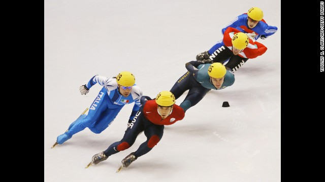 From left, Italian Fabio Carta, American Apolo Anton Ohno, Australian Mark McNee, Hungarian Kornel Szanto and Britain's Nicky Gooch skate during the men's 1,500-meter short-track heats in Salt Lake City in 2002.