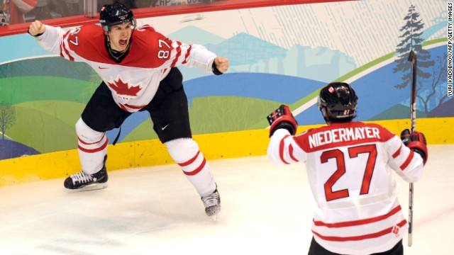 Canadians Sidney Crosby, left, and Scott Niedermayer celebrate as their team wins the gold against the United States in the 2010 Winter Olympics in Vancouver, British Columbia.