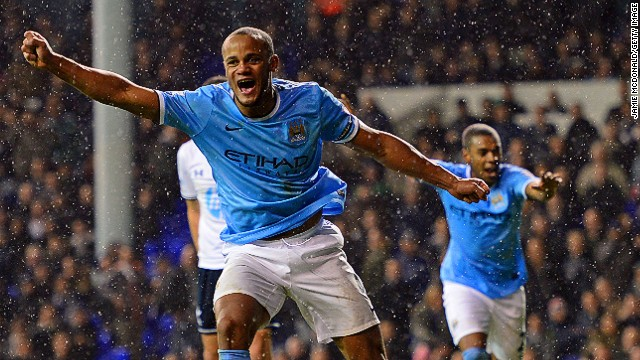 Vincent Kompany celebrates a goal and, more importantly, taking his team back to the top of the English Premier League.
