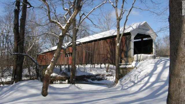 Parke County's famous red covered bridges stand out against its snow-filled meadows.