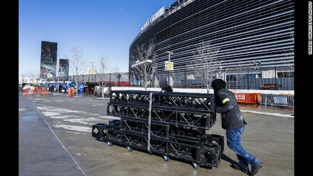 A man moves equipment outside MetLife Stadium in East Rutherford on January 29. The stadium will host the game Sunday.