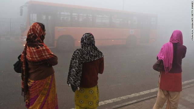 Women in Delhi struggle through the smog. The city has the world's worst pollution according to the WHO.