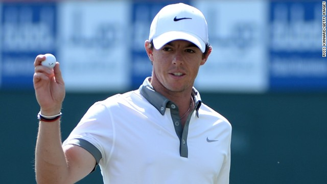 Rory McIlroy acknowledges the galleries after picking up another birdie during his nine-under-par 63 in Dubai.