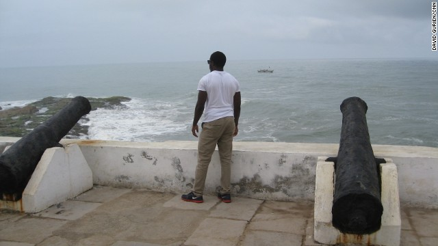 "Duwon Steven Clark stares out to the Atlantic from Cape Coast Castle --one of more than two dozen slave ""castles"" along the coast of what is now Ghana."