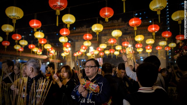 People in Hong Kong burn incense and pray at the Wong Tai Sin Temple on January 30.