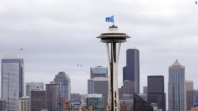"A ""12th Man"" flag honoring Seahawks fans billows in the wind atop the Space Needle in Seattle on January 30."