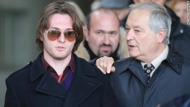 Sollecito, left, and his father Francesco leave after attending the final hearing before the verdict on January 30. After nearly 12 hours of deliberation, the court reinstated the guilty verdict first handed down against Knox and Sollecito in 2009.