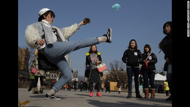 People play a traditional folk game during Lunar New Year celebrations at Namsangol Hanok village in Seoul, South Korea, on January 31.