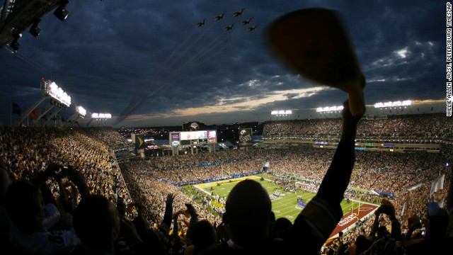 Super Bowl XLIII attendees cheer as the U.S. Air Force Thunderbirds fly over Raymond James Stadium in Tampa, Florida, in 2009.