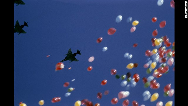 Balloons fill the sky as F-4 Phantom fighter jets fly over Tulane Stadium in New Orleans before Super Bowl VI in 1972.