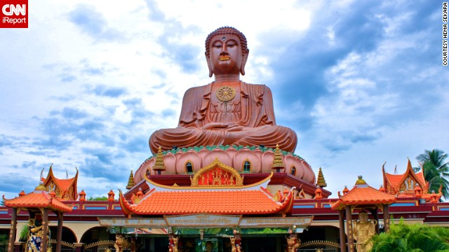 The colorful Wat Machimmaram, a Buddhist temple, features the largest sitting Buddha statue in Southeast Asia. See more photos on CNN iReport.