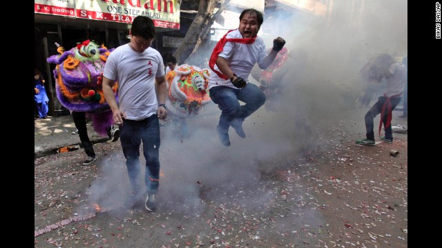 A man jumps over exploding firecrackers during celebrations in Kolkata, India, on January 31.