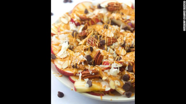Replace corn chips with apples for apple nachos? Sure! This dessert-like dish mixes apples, nuts and coconut along with peanut butter and chocolate.