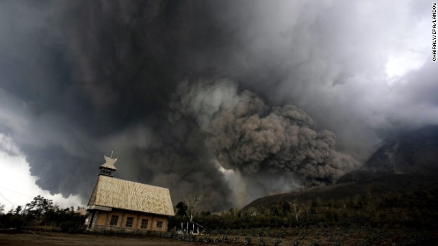 Mount Sinabung fills the sky over Karo, North Sumatra, Indonesia, with smoke and ash as it erupts on Saturday, February 1. The volcano has been erupting since September.