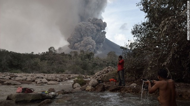 A villager in Karo, North Sumatra, Indonesia, bathes in the river while Mount Sinabung erupts, spewing lava and giant clouds of ash on January 21. The volcano, which has been erupting since September, has driven tens of thousands of people from their homes.