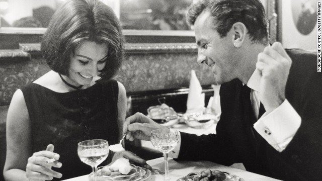"Loren has dinner with Schell at a restaurant in Hamburg, Germany, during the filming of ""The Condemned of Altona"" in 1962."