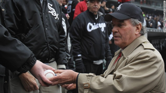Former Chicago mayor Richard M. Daleysigns an autograph at a White Sox game in 2011.