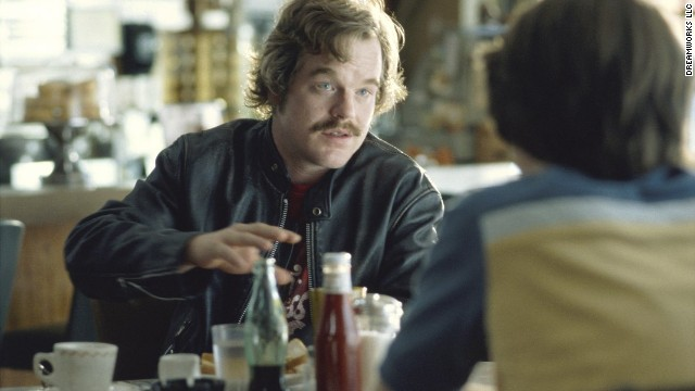 "Hoffman plays Lester Bangs in 2000's ""Almost Famous."" He delivers one of the film's most memorable scenes when he advises Patrick Fugit's character, William Miller, that ""the only true currency in this bankrupt world is what we share with someone else when we're uncool."""