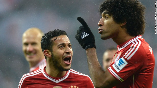 Thiago congratulates defender Dante after he scored Bayern's fourth goal in the victory over Frankfurt.