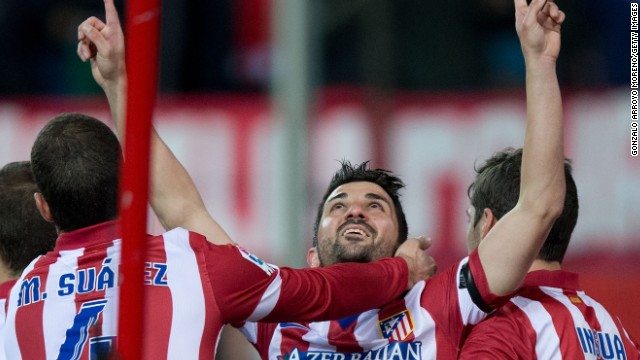 David Villa pays his own emotional tribute to his former Spain national coach Aragones after scoring Atletico's opener.