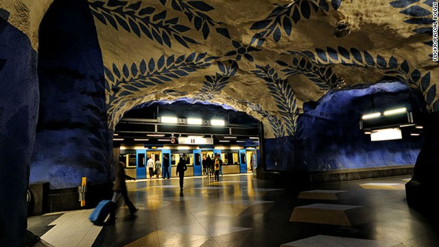 Stockholm's central station gets stranger the further you descend, until you reach the cave-like platform level, with its abstract floral designs.