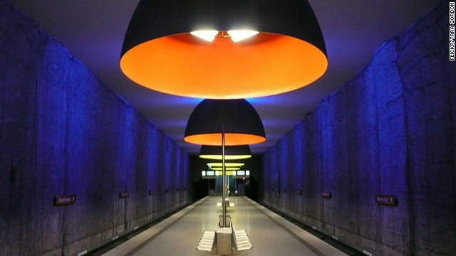 Enormous dome lights, bathing the platforms in haunting blue, red and yellow, make Munich's otherwise ordinary Westfriedhof station roar.