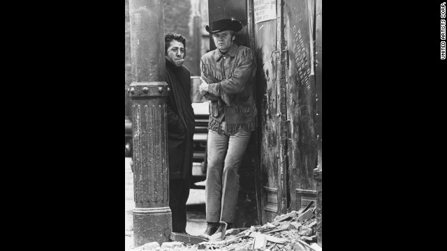"""Midnight Cowboy,"" starring Dustin Hoffman and Jon Voight, turns some audiences off with its liberal helpings of sex, seediness and its X rating. But that doesn't stop the Oscars from awarding it best picture, best director for John Schlesinger and best adapted screenplay for Waldo Salt at the ceremony held in 1970."