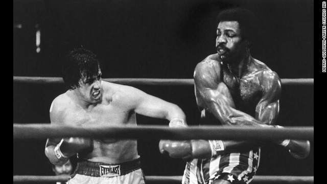 "Sylvester Stallone, left, takes on Carl Weathers in the ring in the 1976 classic ""Rocky."""