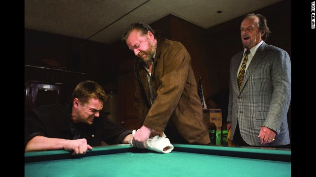 "Director Martin Scorsese's films were often well-reviewed but couldn't win the big prize, until ""The Departed,"" about a Boston gangster and some corrupt cops. The film stars Leonardo DiCaprio, left, Ray Winstone, and Jack Nicholson, right."