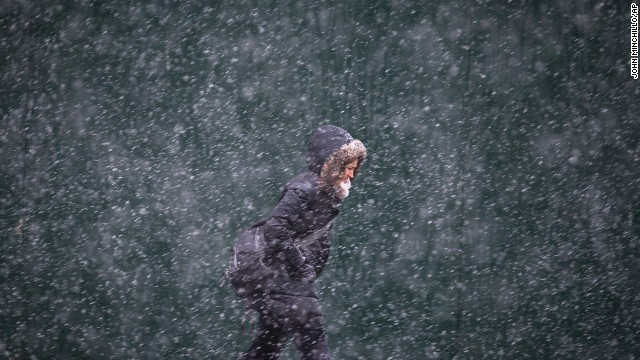 A pedestrian walks against the snow and wind on 42nd Street in New York on February 3.