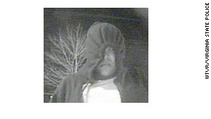 Surveillance photos show one of two men investigators want to talk to about Kevin Quick\'s disappearance.
