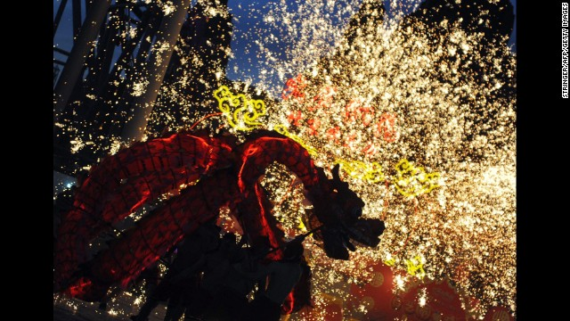 Fireworks explode around a dragon puppet during a performance in Beijing on February 3.