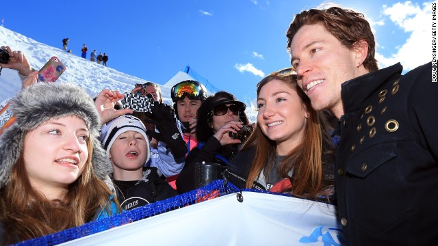 The Winter Olympics are cool for kids. Here the world's most famous snowboarder Shaun White poses for a photo at the Sprint U.S. Grand Prix at Park City Mountain, Utah.