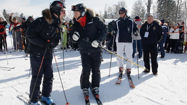 Russian President Vladimir Putin (center, with Prime Minister Dmitry Medvedev) is a regular skier in Sochi. Could he be tempted to go down the slopes during the Winter Olympics?