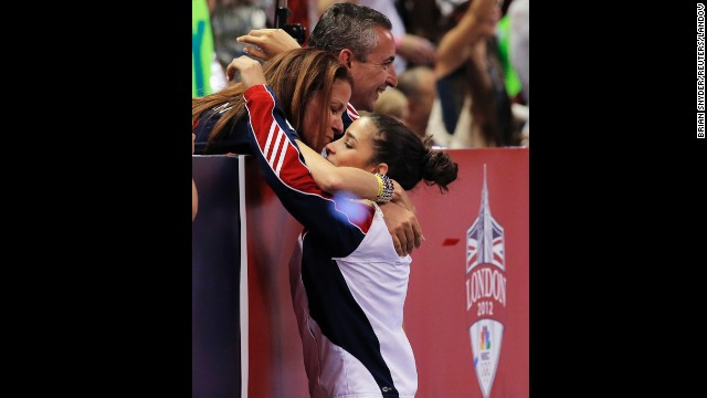 U.S. gymnast Aly Raisman gets a hug from her parents, Rick and Lynn, after being named to the Olympic team in 2012.