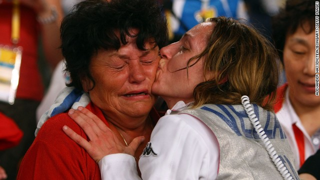 Italian fencer Valentina Vezzali kisses her mother, Enrica, after winning a gold medal at the 2008 Olympic Games.