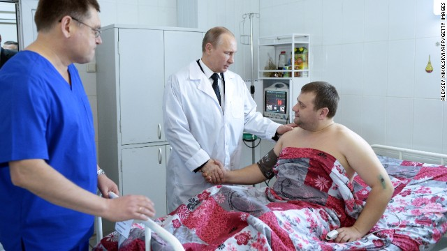 "Putin visits a clinic where terrorist attack victims are being treated in Volgograd on January 1. The twin suicide strikes killed 34 and raised concerns over security at the Sochi Winter Olympic Games. Putin called Russia's deadliest bombings in three years an ""abomination."""