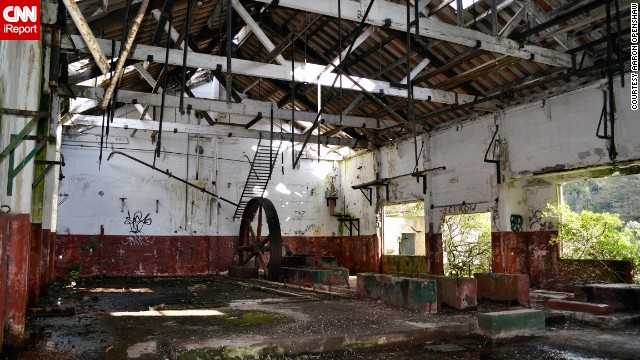 Inside the building was a large, rusty steel wheel and walls painted in a red and white horizon line paint scheme.