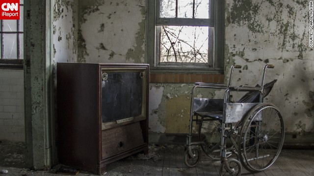 """The dust on the TV and wheelchair shows how untouched parts of the hospital are and will remain,"" Kina said."